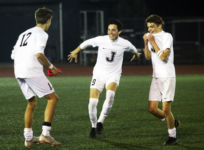TIMES PHOTO: DAN BROOD - Jesuits (from left) Floor Van Hemeren, Oscar Baudey and Truman Delaney get ready to celebrate following the Crusaders 1-0 state playoff win at Tigard on Tuesday.