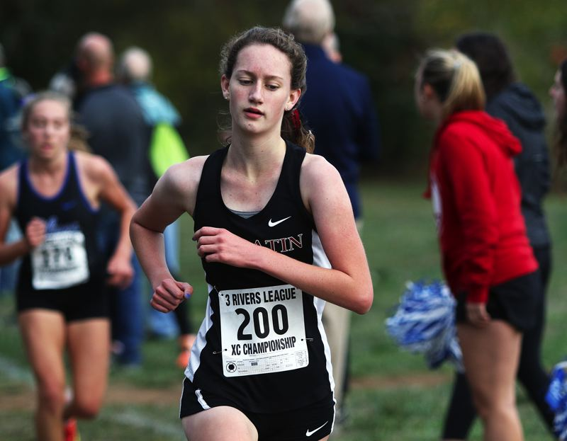 TIMES PHOTO: DAN BROOD - Tualatin High School junior Kaitlyn Gearin took second place in the varsity girls race at the Three Rivers League district meet.