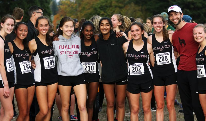 TIMES PHOTO: DAN BROOD - The Tualatin High School girls cross country team is going to the Class 6A state meet after taking second place at the TRL district event.