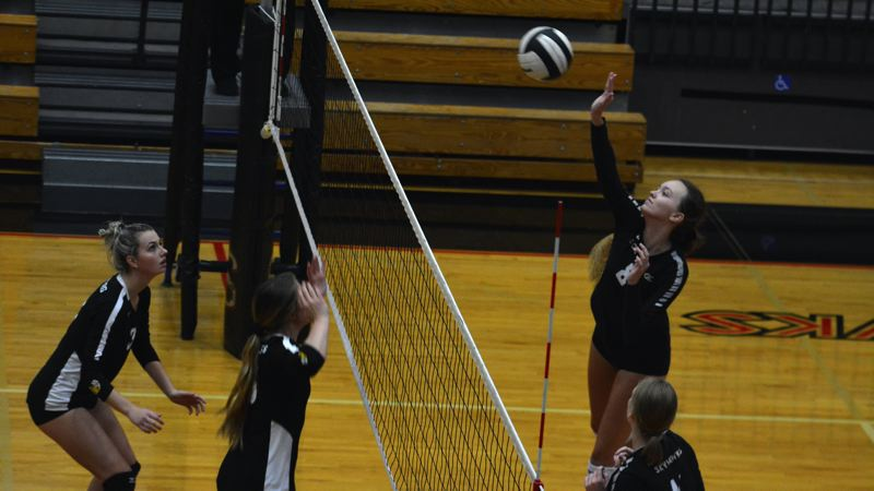 TIMES PHOTO: MATT SINGLEDECKER - Southridge outside hitter Emma Jansen hammers home a kill against Newberg.