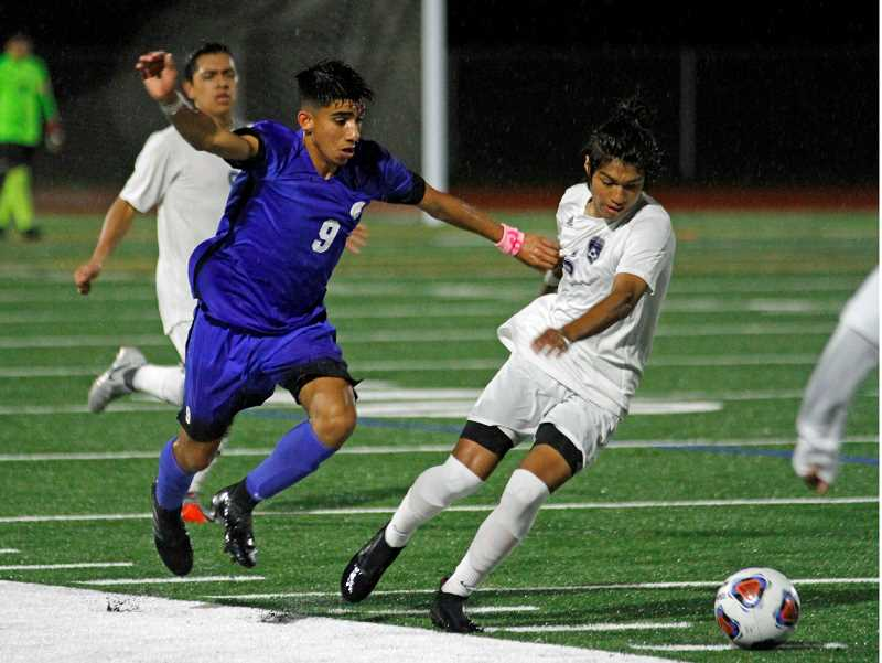 PAMPLIN MEDIA GROUP PHOTO: WADE EVANSON - Wilsonvilles Angel Ulloa works past a Hillsboro player to maintain possession of the ball.