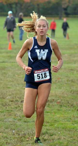 SPOKESMAN PHOTO: TANNER RUSS - Junior Samantha Prusse took first place in the varsity race.