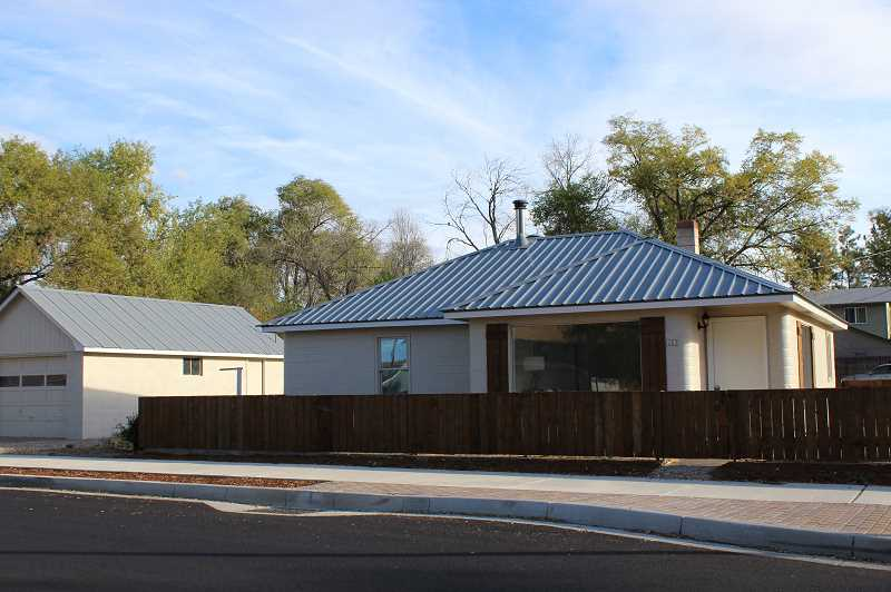 HOLLY M. GILL/MADRAS PIONEER - The H Street house and garage have been completely renovated, changing the look of the neighborhood.