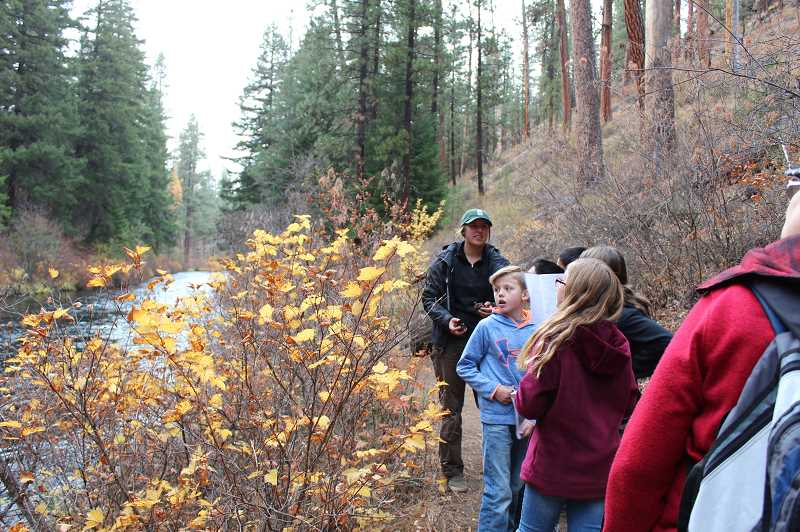 JENNIFFER GRANT/MADRAS PIONEER - Fisheries biologist Megan Mooney leads students on a hike along the river, where they saw kokane salmon.