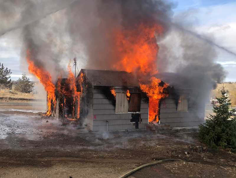 SUBMITTED PHOTO - Once firefighters were finished practicing on a 'burn to learn' house on South Adams Drive, the house was quickly engulfed in flames.