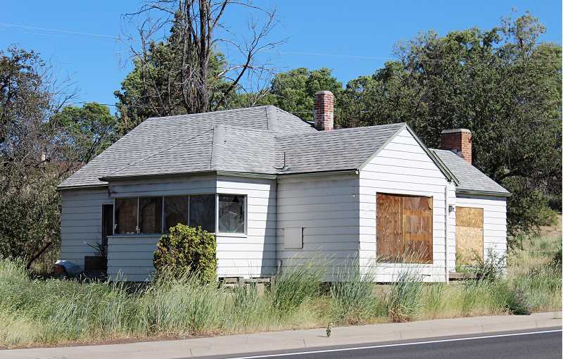 HOLLY M. GILL - A boarded up house, which once sat on U.S. Highway 97, across from McDonald's, was one of the city's first code enforcement projects under its earlier nuisance and abatement ordinance.