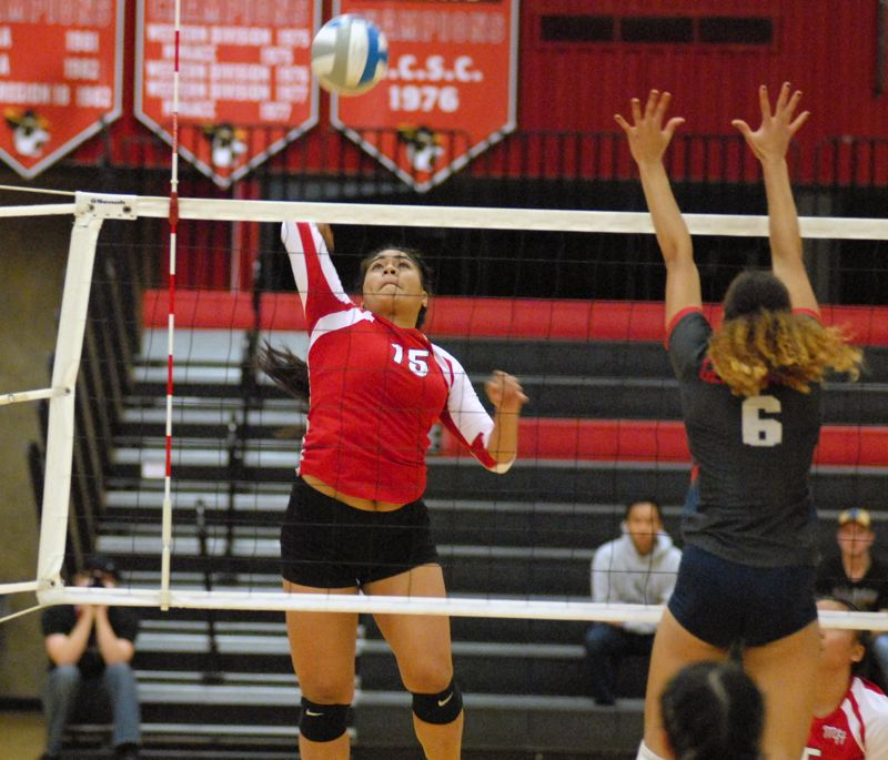 GRESHAM OUTLOOK: MATT RAWLINGS - Mt. Hood's Lea'a Puleiala rises up at the net and finishes off one of her 19 kills on the night. But it wasn't enough as the Saints fell to Clackamas in four games.
