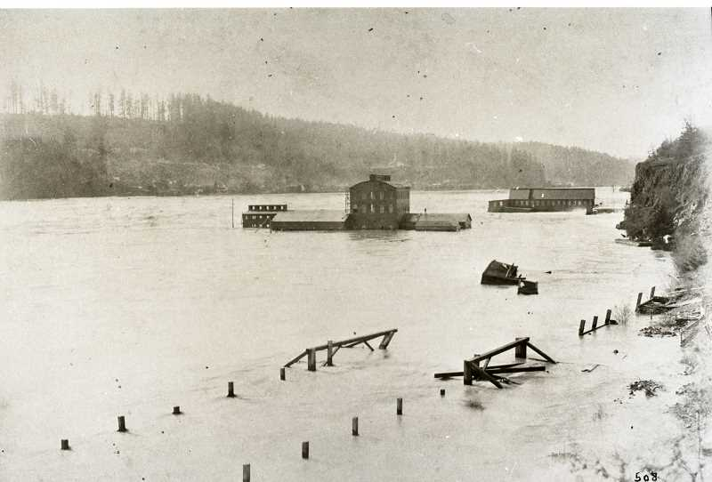 PHOTO COURTESY CLACKAMAS COUNT HISTORICAL SOCIETY - West Linns Crown paper mill was innundated during flooding of the Willamette River in 1890.
