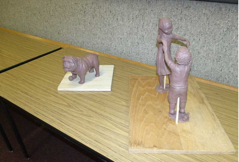 JUSTIN MUCH - Models of the proposed sculptures for the Woodburn Downtown Plaza were displayed at the Public Art and Mural Committee meeting Oct. 30.