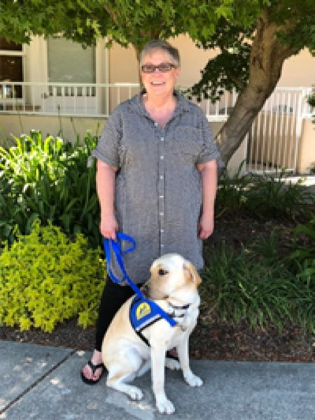 PHOTO COURTESY OF JANICE FALTERSACK - Janice Faltersack poses with Tilda, a new service dog she handles on behalf of the Crime Victims Assistance Program in Columbia County.