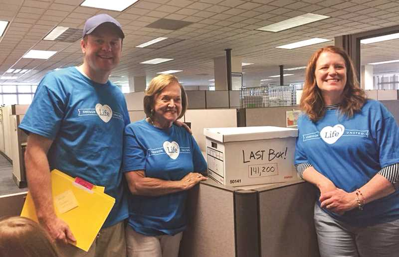 PHOTO SUBMITTED BY RORY RODGERS  - Jeff Jimerson and associates with the final box of signed petitions for Ballot Measure 106.