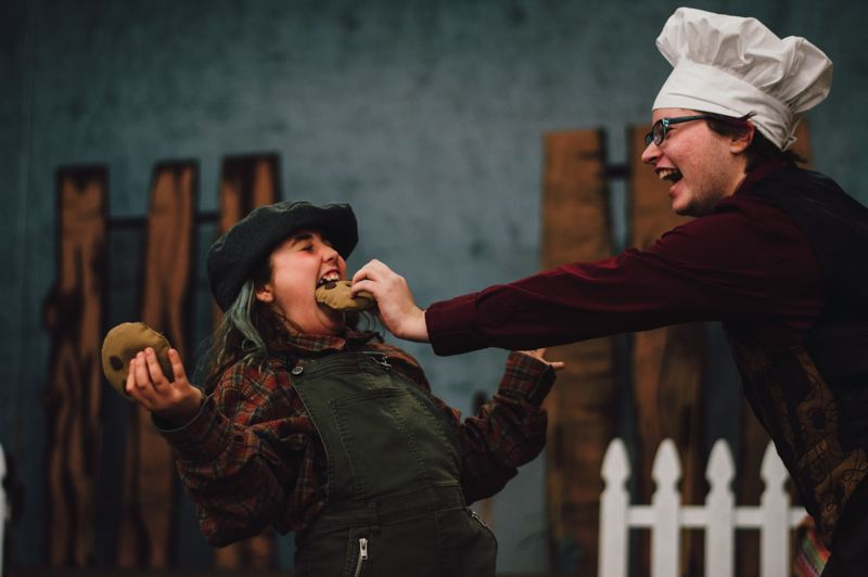 CONTRIBUTED PHOTO: JESSICA WINTERS - Taylor Breckenridge (playing Toad) shoves a prop cookie into Ania Viliuss mouth (playing Frog) during a rehearsal of the playA Year with Frog and Toad.