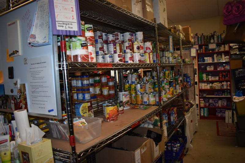 OUTLOOK PHOTO: MATT DEBOW - The pantry is stocked with donated food for residents to take while they are staying in the shelter.