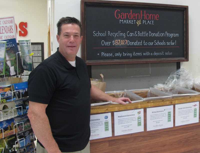 PHOTO BY BILL GALLAGHER - Garden Home Thriftway manager Mike Babbitt prepares to distriubutre more than $15,000 to the elementary schools shoppers have donated thier empties to.