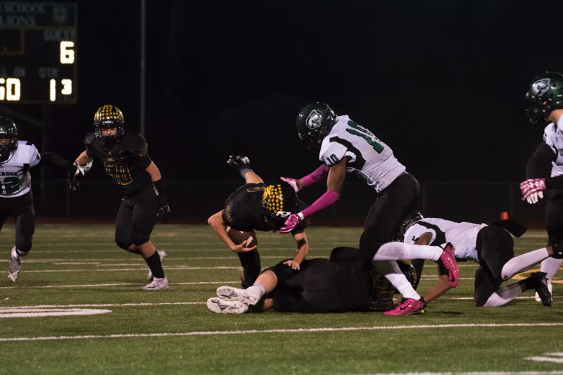 PHOTO COURTESY: JEREMY DUECK - St. Helens running back Isaiah Bettencourt dives for a few extra yards against Parkrose.