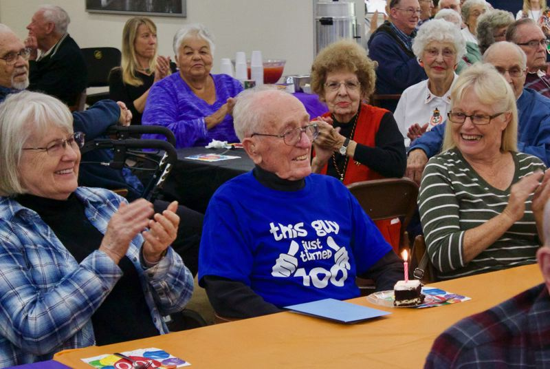 OUTLOOK PHOTO: CHRISTOPHER KEIZUR - Russ Sichley joked that he needed everyones help blowing out the candle during his 100th birthday celebration.