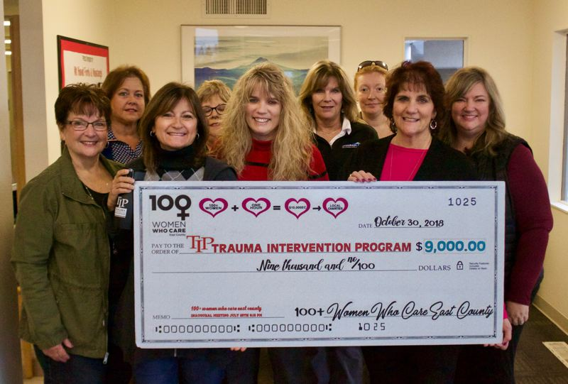 OUTLOOK PHOTO: CHRISTOPER KEIZUR - 100 Women Who Care donates $9,000 to TIP