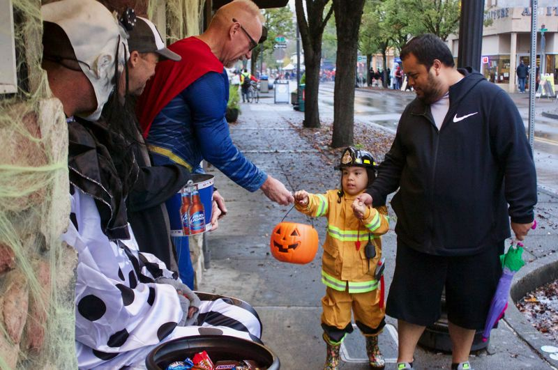 OUTLOOK PHOTO: CHRISTOPHER KEIZUR - Most of the downtown businesses gave out candy to the costumed trick-or-treaters during the annual event Wednesday, Oct. 31.