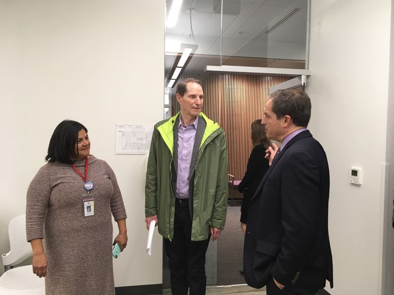 TIMES PHOTO: PETER WONG - U.S. Sen. Ron Wyden, D-Ore., listens to Serena Cruz, left, executive director of the Virginia Garcia Memorial Foundation, and Gil Mu?±oz, right, chief executive officer of Virginia Garcia Memorial Health Center, on Tuesday, Oct. 30, at its new Beaverton Wellness Center.