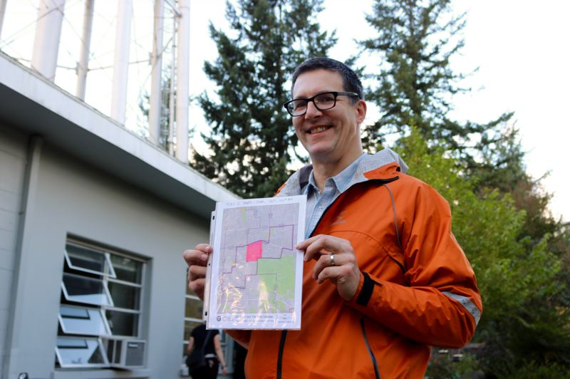 TRIBUNE PHOTO: ZANE SPARLING - Marshall Runkel, chief of staff for Commissioner Chloe Eudaly, holds up a map showing the area he distributed door-hangers on Friday, Nov. 2.