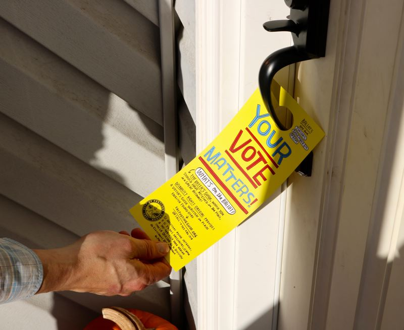 TRIBUNE PHOTO: ZANE SPARLING - This bright-yellow door-hanger reminding residents to vote was distributed by Chloe Eudaly's office on Friday, Nov. 2 in East Portland.