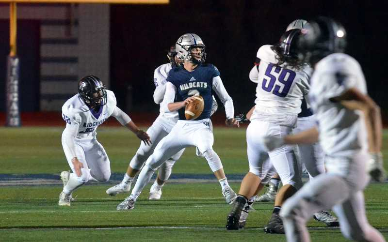 SPOKESMAN PHOTO: TANNER RUSS - Wilsonville quarterback Nathan Overholt had a big night scoring, and helped set the stage for his teams 54-20 victory over Ridgeview.
