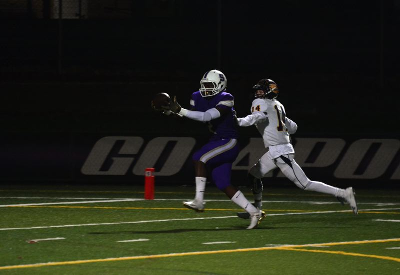 TIMES PHOTO: MATT SINGLEDECKER - Sunset senior Marve Nyembo scored two touchdowns against Bend in the first round of the 6A playoffs.