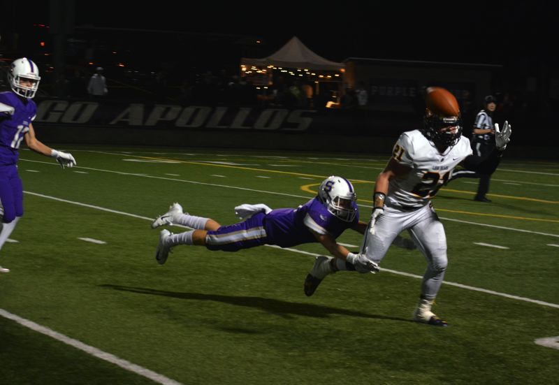TIMES PHOTO: MATT SINGLEDECKER - Sunset senior defensive back Trey Marchesi lays out for deep pass against Bend.