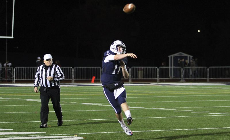 REVIEW PHOTO: MILES VANCE - Lake Oswego senior quarterback Jackson Laurent threw for four touchdowns during his team's 42-6 victory over North Medford in the first round of the Class 6A state playoffs on Friday at LOHS.