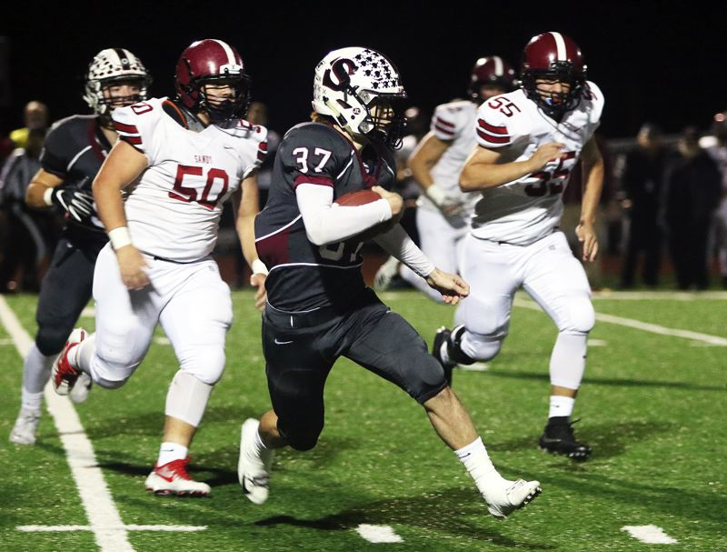 TIMES PHOTO: DAN BROOD - Sherwood sophomore Clay Peden heads up field in front of Sandy's Ford McKinnis (5) and Ethan Lucore during Friday's playoff game.