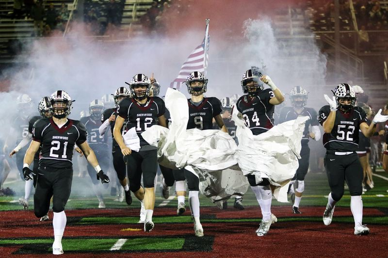 TIMES PHOTO: DAN BROOD - The Sherwood High School football team takes the field prior to Friday's state playoff game with Sandy.
