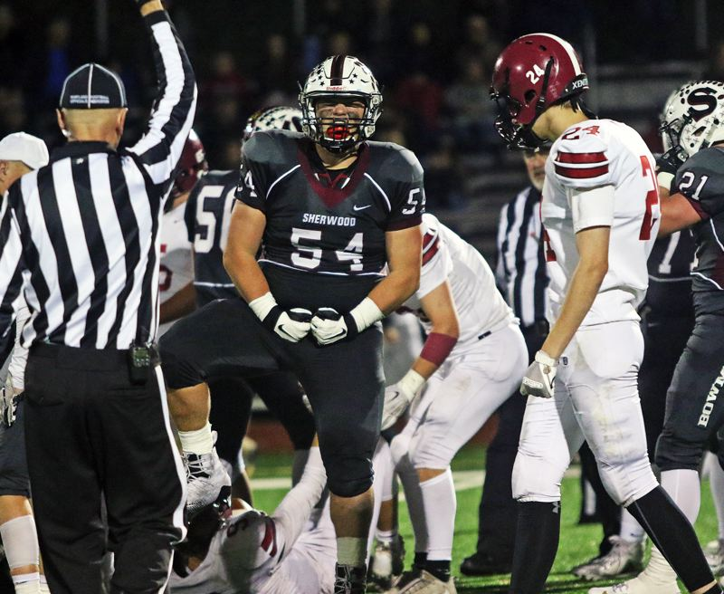 TIMES PHOTO: DAN BROOD - Sherwood junior Nick Severson (54) celebrates after making a defensive play during the Bowmen's 42-14 state playoff win over Sandy.