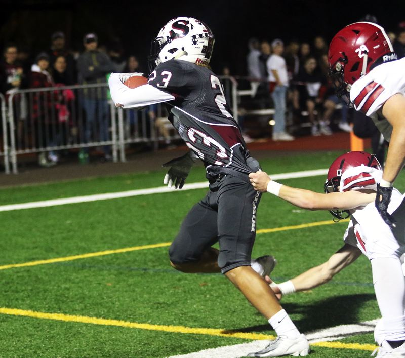 TIMES PHOTO: DAN BROOD - Sherwood junior Jamison Guerra gets into the end zone on the receiving end of a 19-yard pass play during the Bowmen's win over Sandy.