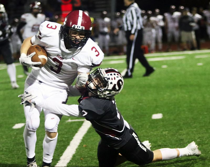 TIMES PHOTO: DAN BROOD - Sandy junior Colby Carson (left) tries to get away from Sherwood senior Noah Beeks during Friday's state playoff game.