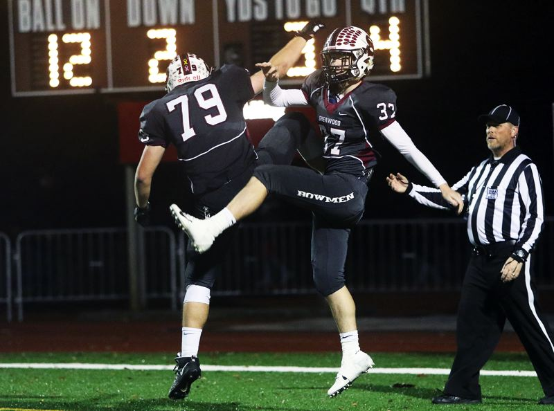 TIMES PHOTO: DAN BROOD - Sherwood sophomore Noah Culbertson (7) and Clay Peden celebrate following Peden's touchdown run in the Bowmen's state playoff win over Sandy.