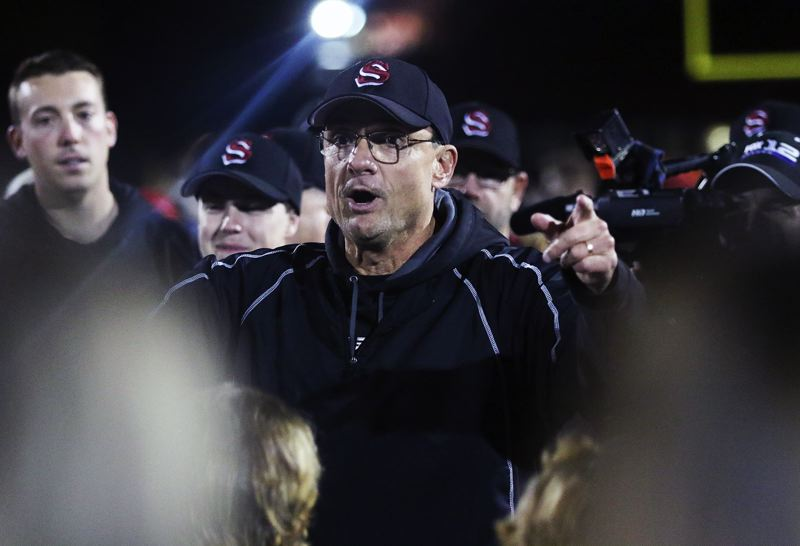 TIMES PHOTO: DAN BROOD - Sherwood High School football coach Greg Lawrence talks to his team, and the Bowmen fans, following the 42-14 state playoff win over Sandy.
