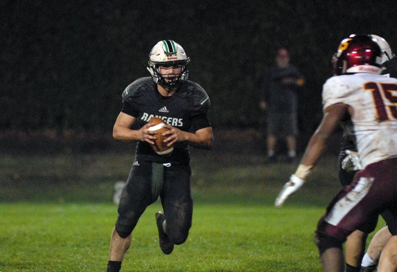 ESTACADA NEWS: MATT RAWLINGS - Quarterback Nick Keller runs down the line before pitching the ball to the outside on an option play in Estacada's 42-19 win over Ontario on Friday.