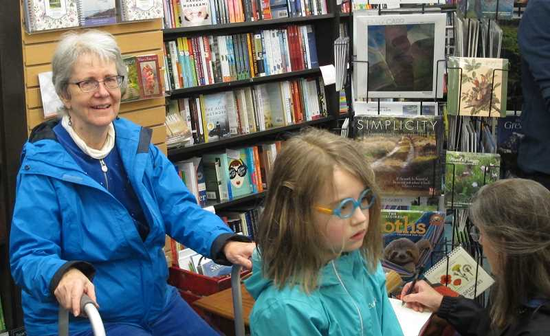 Diane Budner has been a customer at Annie Bloom's Books for all forty of its years.  'I've always enjoyed the warmth of the store and the friendly workers I've seen over the years at the counter,' she said at the anniversary celebration.
