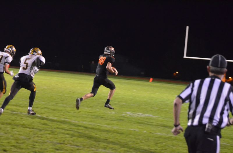 PAMPLIN MEDIA GROUP PHOTO: JOHN BREWINGTON - Scappoose wide receiver Gavin Larson is behind the secondary on his way to an 80-yard touchdown on a reception from Jakobi Kessi during Friday night's 20-14 victory over North Bend.