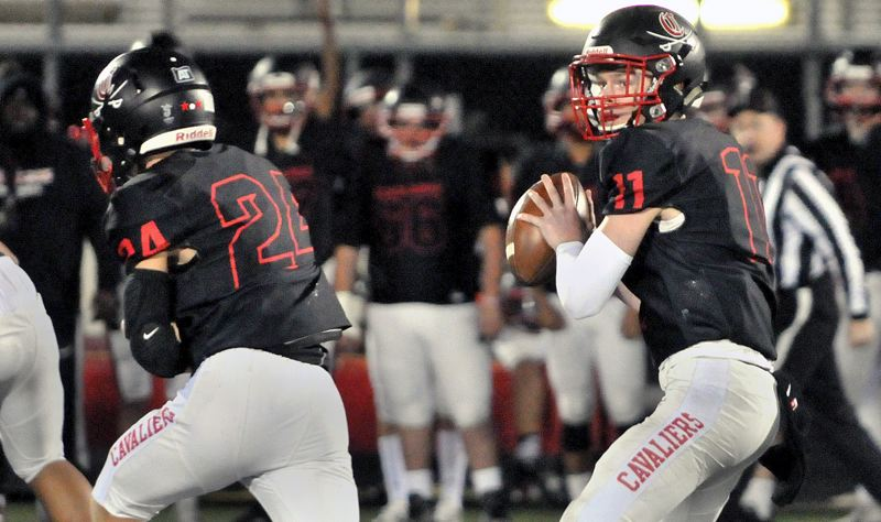 PAMPLIN MEDIA: GARY ALLEN - Clackamas quarterback Austin Atkeson (11) passed for 225 yards and three touchdown in Friday's 48-0 home win over Newberg in the opening round of the OSAA Class 6A football playoffs.