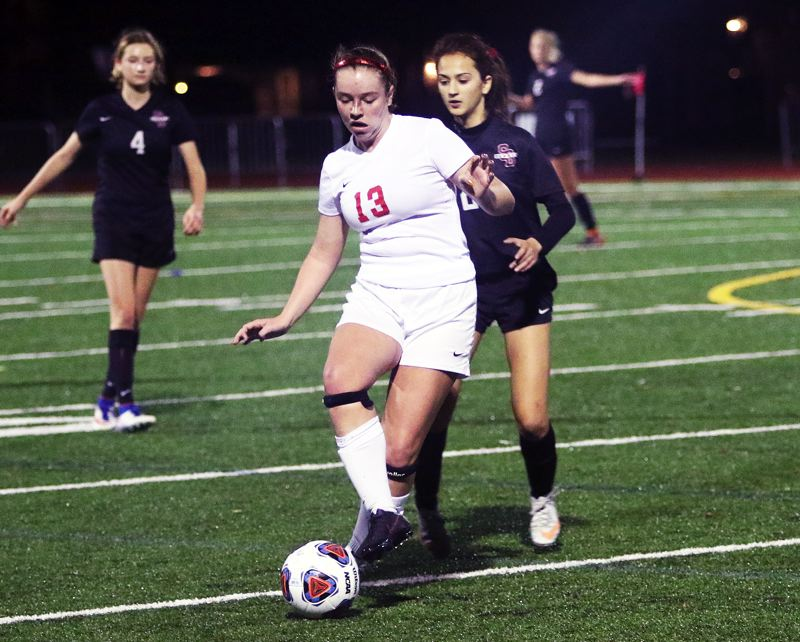 TIMES PHOTO: DAN BROOD - Westview sophomore Keely Rooker controls the ball during the Wildcats' playoff match at Sherwood.