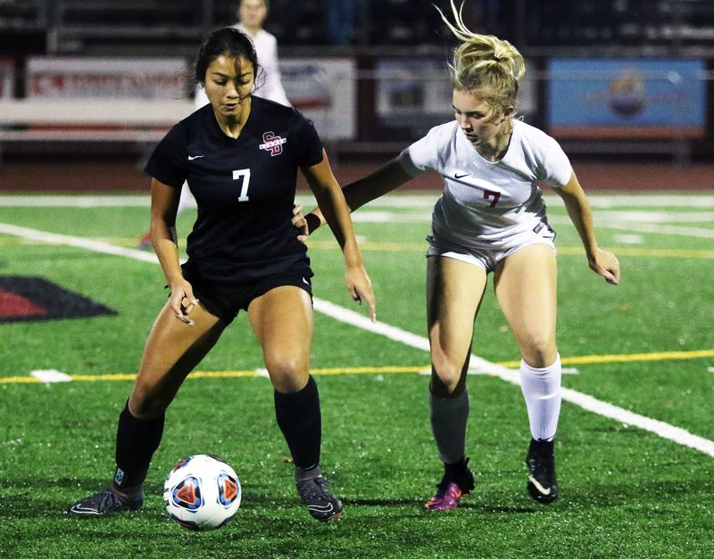 TIMES PHOTO: DAN BROOD - Sherwood junior Loma McNeese (left) controls the ball against Westview junior Kiara Admas during the state playoff match.