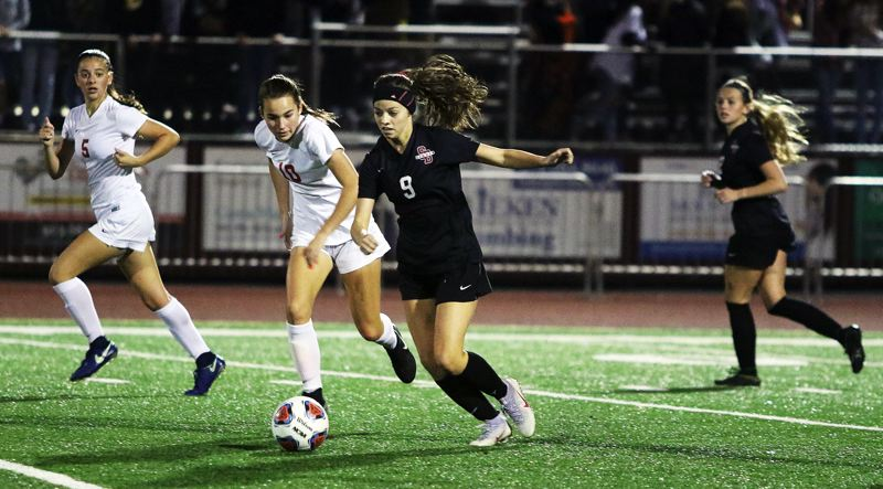 TIMES PHOTO: DAN BROOD - Sherwood junior Jillian Leroux (9) hurries the ball upfield during the state playoff win over Westview.