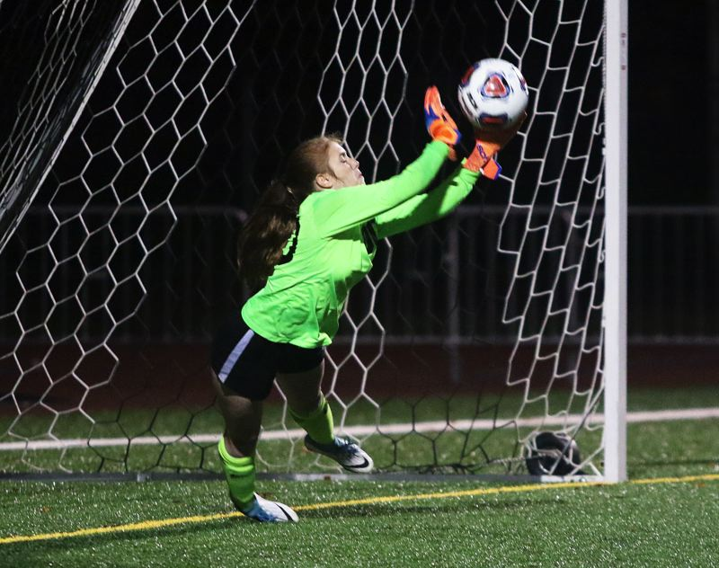 TIMES PHOTO: DAN BROOD - Sherwood junior goalkeeper Jadie Baldwin dives out to make a block during the penalty kick shootout in the Lady Bowmen's state playoff victory over Westview.
