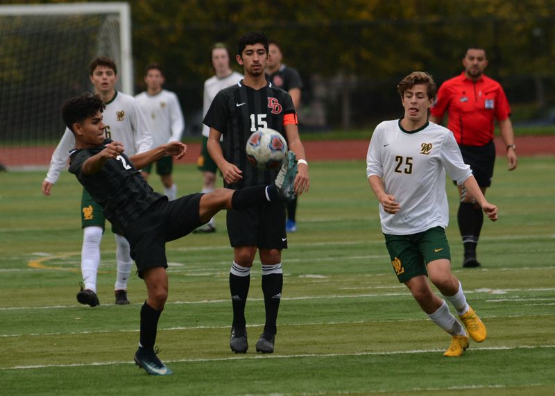 OUTLOOK PHOTO: DAVID BALL - David Douglas Miguel Ordaz steps in front of West Linns Owen Caba to win a ball in the midfield during the Scots 2-1 quarterfinal win Saturday.