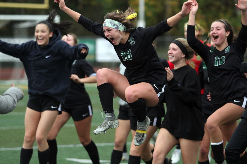 TIDINGS PHOTO: MILES VANCE - West Linn senior Rae Peters (center) and her teammates celebrate at the end of their 2-0 win over Barlow in the Class 6A state quarterfinals on Saturday at West Linn High School.