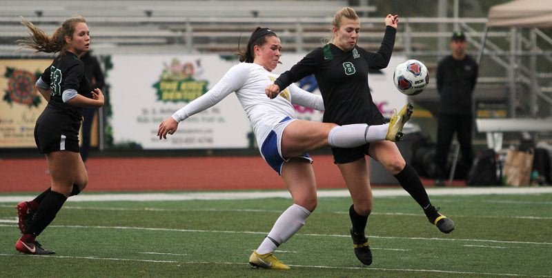 PAMPLIN MEDIA GROUP PHOTO: MILES VANCE - Barlow sophomore Abi Hoffman kicks the ball past West Linn's Cami Fulcher during the Bruins' 2-0 loss in the Class 6A state quarterfinals on Saturday at West Linn High School.