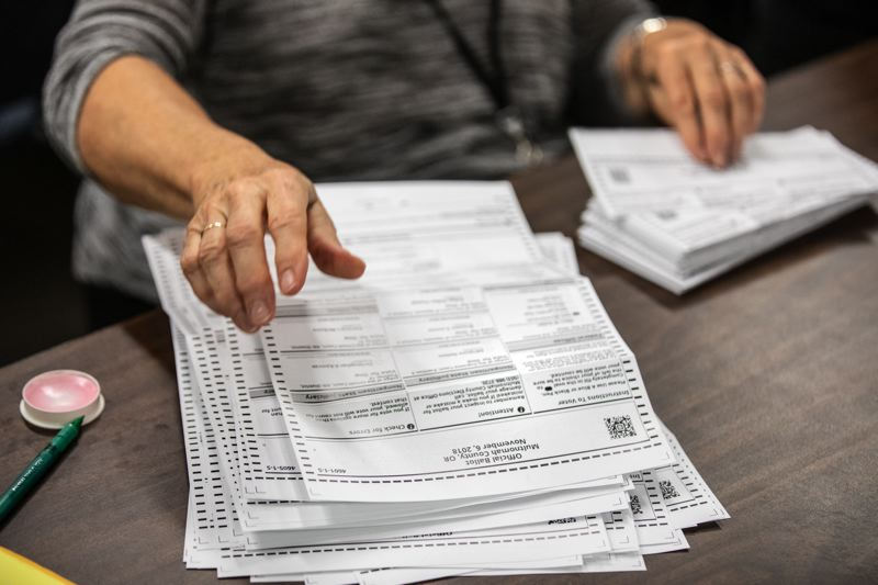 PAMPLIN MEDIA GROUP FILE PHOTO - Oregon's vote-by-mail ballots are opened and scanned at local elections offices.