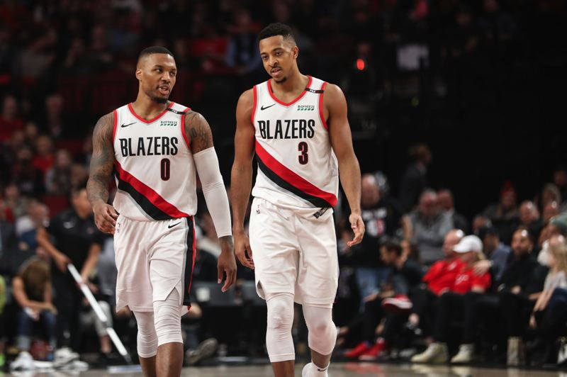 TRIBUNE PHOTO: DAVID BLAIR - Damian Lillard (left) and CJ McCollum have been a dynamic duo for the Trail Blazers in the team's 7-3 start to the 2018-19 NBA season.