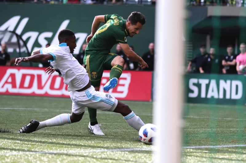 TRIBUNE PHOTO: JAIME VALDEZ - Sebastian Blanco scores the go-ahead goal for the Portland Timbers in the 29th minute Sunday against the Seattle Sounders.